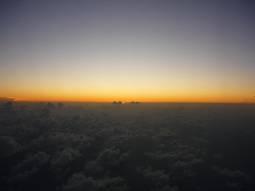 Sun setting behind the clouds