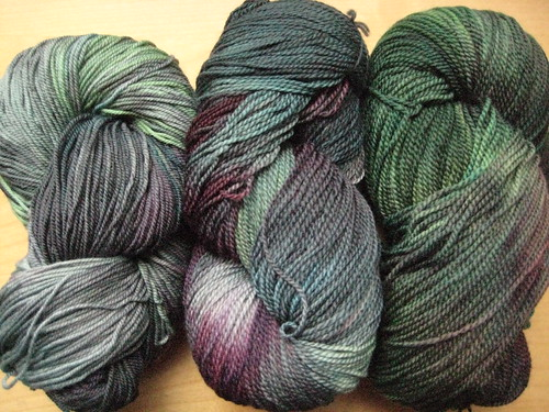 Purple, acid green, turquoise and red washed in shades of grey...the colours mix differently in every skein!