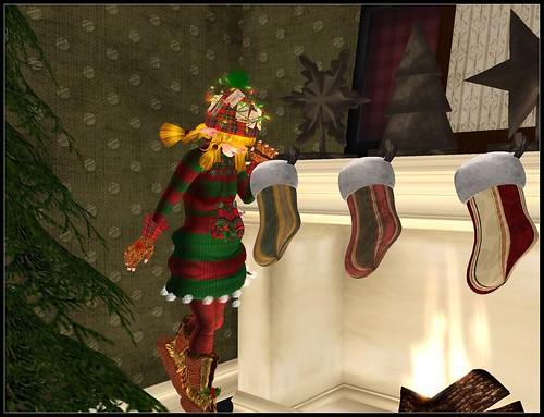 Elf peeking into a christmas stocking