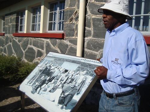 Former prisoner with Picture of him and others including Mandela