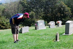 CSP looking at a child's gravestone at St. John's Episcopal Church in Valle Crucis, NC