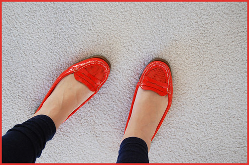 insanely bright red-orange loafers