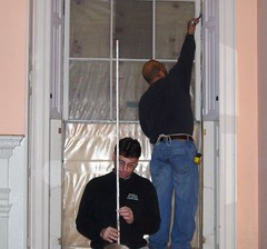 Carpenters Demonstrate Removal of Window Stops