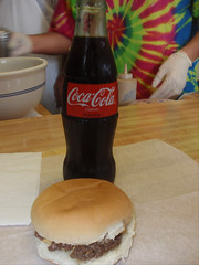 classic combo: cheeseburger and bottle of coke