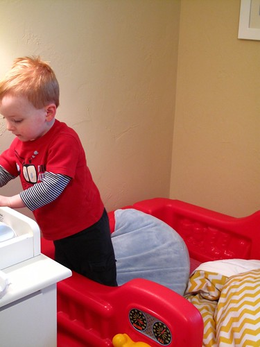 playing in his bigboy bed