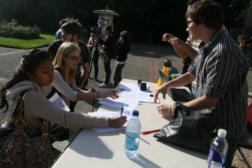 Junior Kevin Kunze (far right) organized a protest to gather signatures for a petition opposing the proposed schedule.  Photo by Melissa Stihl/Foghorn