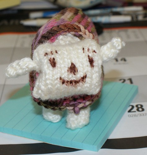 Toy sheep with Sharpie-drawn face