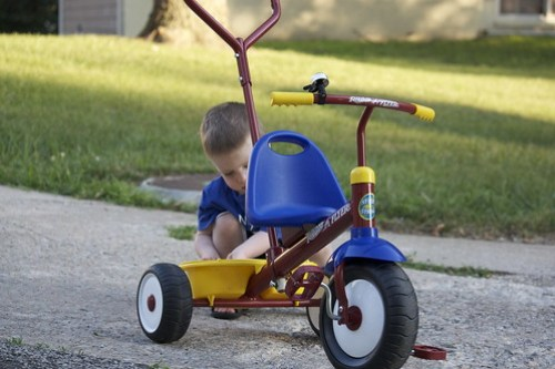 playing with a tricycle