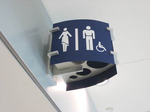 Bathroom sign at Indianapolis airport. Seems like the women are curvier and sexier and the men are more buffed and manlier in Indianapolis.