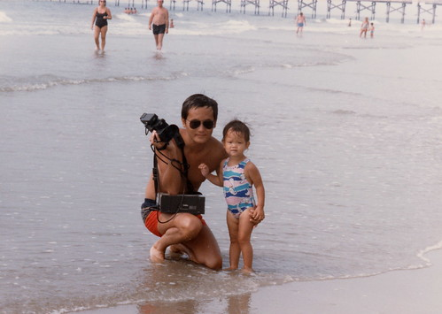 Cameras, ocean, and daughter (Couch Potato): he couldnt be any happier (and see, hes smiling!)