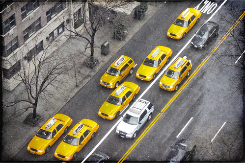 Cabs in the rain