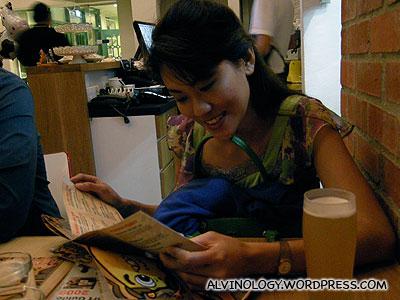 Rachel going through the menu