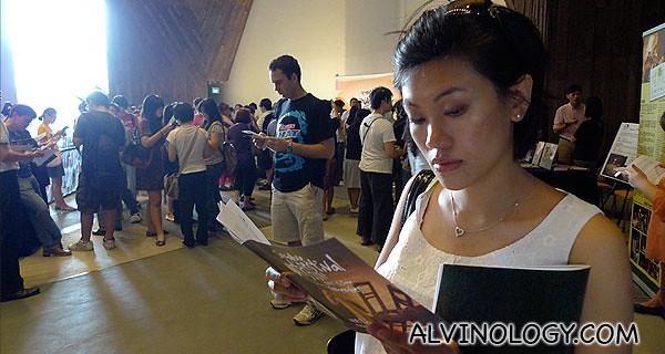 Rachel reading the production booklet