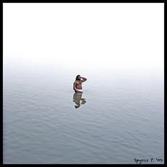 Yogi meditating in the Ganges