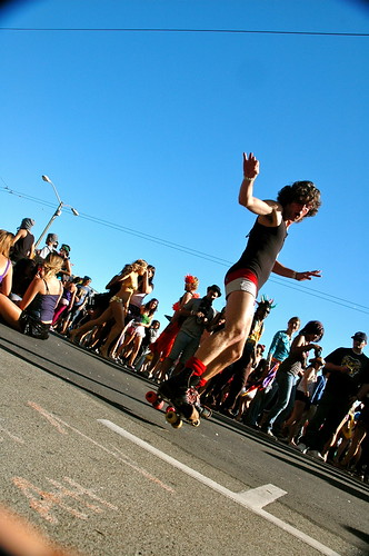 A roller skater glides past City Hall at LovEvolution enjoying the electronic music.  Photo by Adam Ross/Foghorn