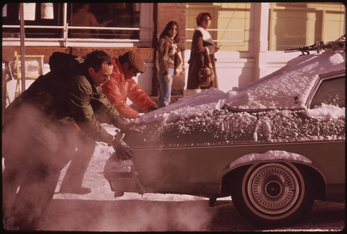 Helping Hands Will Get This Skier's Car off the Ice 02/1974
