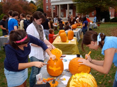 Students work on their pumpkins at this years contest, which was sponsored by Dining Services.  They provided the pumpkins, carving tools and prizes for the event.