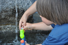 filling up the water pistol