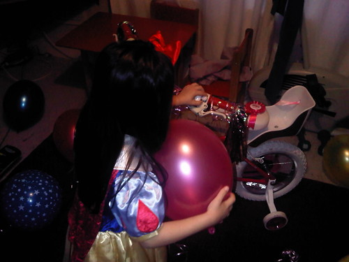 Snow White finds a bike in the front room!!