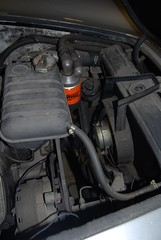 Radiator header tank, alternator, oil filter, ...