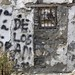 Graffiti on dilapidated inn on Old Silk Route Walk