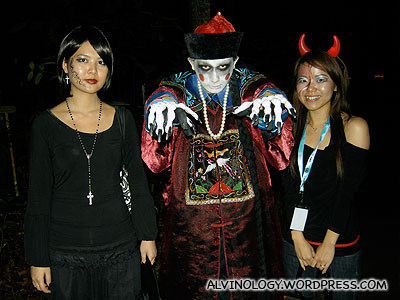 The ladies forced this poor Chinese zombie to pose with them