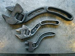 the three curvy wrench tools