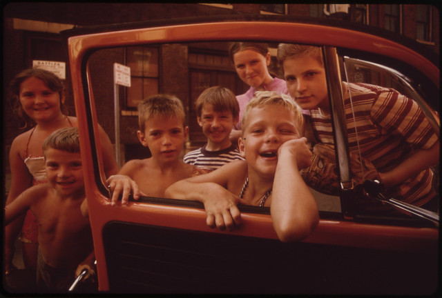"""Youngsters in """"Over the Rhine"""" Residential Neighborhood North of the Business District. They Want the Photographer to Take """"Just One More"""" Picture 09/1973"""