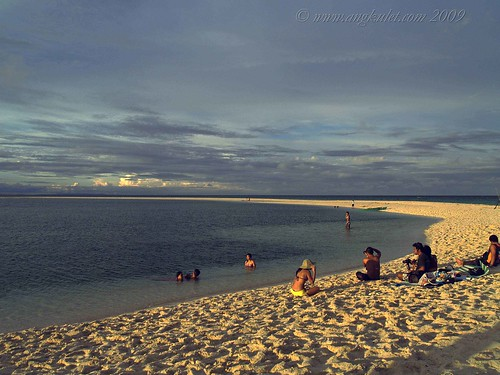 Sunbathers in White Island, Camiguin
