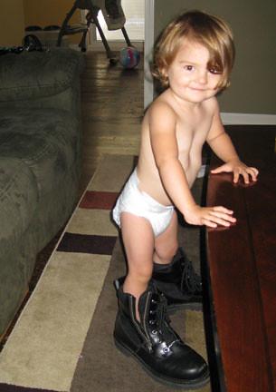 Skyler wearing Daddys motorcycle boots!