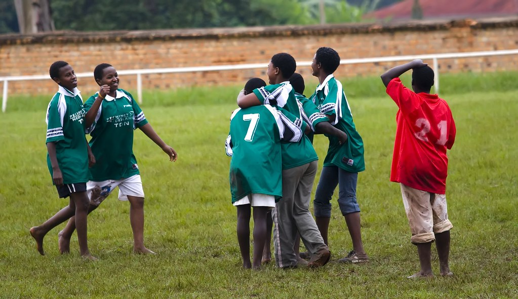 Girls from Ngoma celebrate the only goal of the match while a player from Tumba sector despairs.