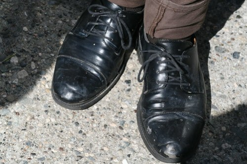 Well worn black lace ups complete the ensemble.