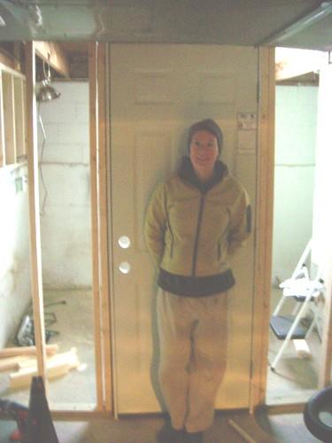 Em in front of the working door