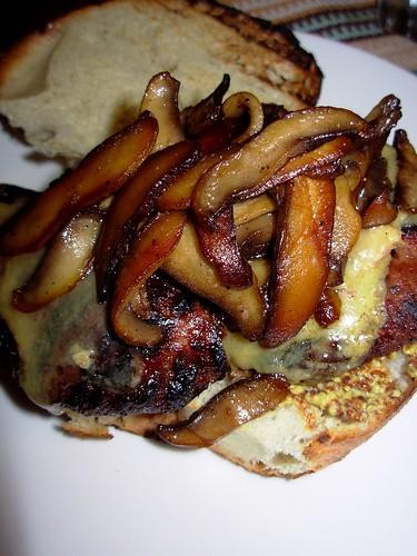 Grilled burger with stilton and portobello mushrooms