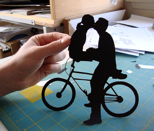 handcut paper, kiss on bicycle