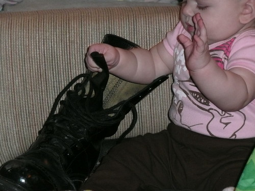 baby with daddy's boots