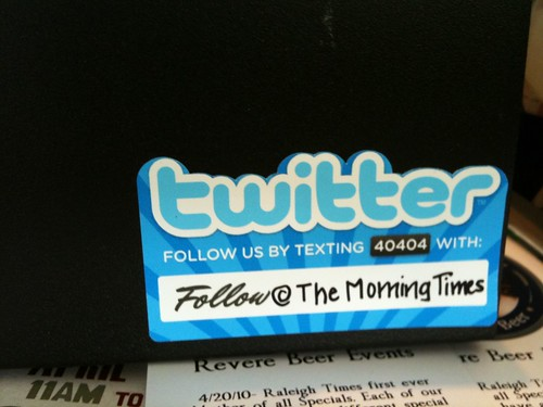 How Morning Times promoting their Twitter account on the cash register