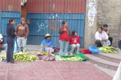 Women selling palm branches outside a Catholic Church