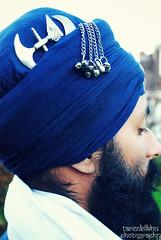Dastaar (Taren Bilkhu) Tags: blue portrait sun man love beard martial outdoor traditional arts lion culture martialarts sword crown turban sikh bana sikhism singh sikhi gatka khanda dastaar shastar vision:sky=0787 vision:outdoor=0845