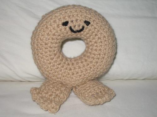 Crocheted bagel being
