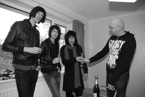 LostAlone supping Champange in celebration