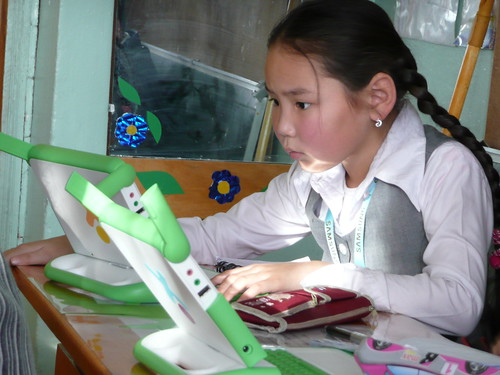 Mongolian girl with XO by One Laptop per Child.