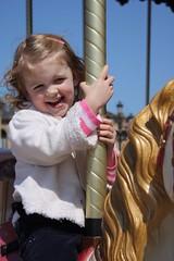 Claire on the merry-go-round in San Sebastián