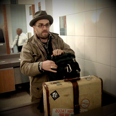 Dave Olson and the old timey suitcase by KK