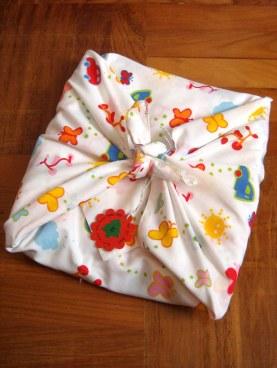 Furoshiki-style fabric gift wrapping