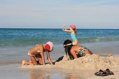 Building a sand castle.