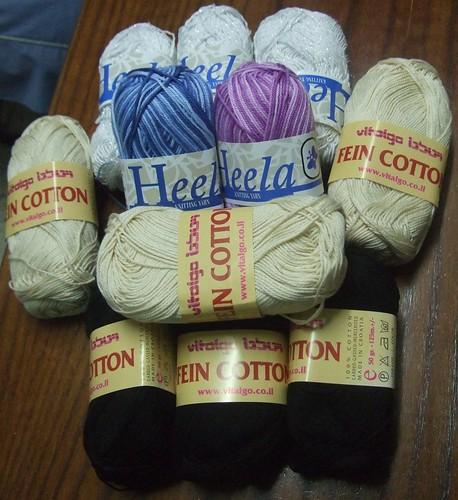 5 balls Heela cotton in white, blue and purple, 6 balls Vitalgo Fein Cotton in black and ecru