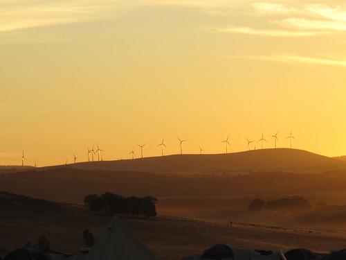 sunrise rolling hills windmills