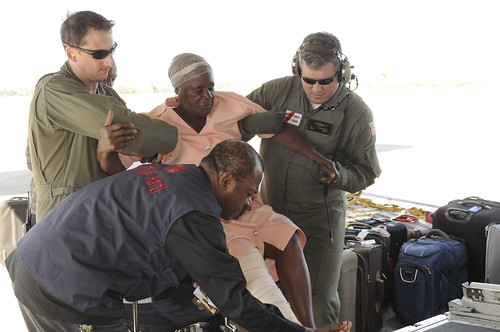 100114-G-1330O-104 Coast Guard crew evacuates injured from Haiti by US Coast Guard Auxiliary.