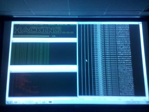 A screenshot of a projector showing some scary terminals that are doing nothing at all.
